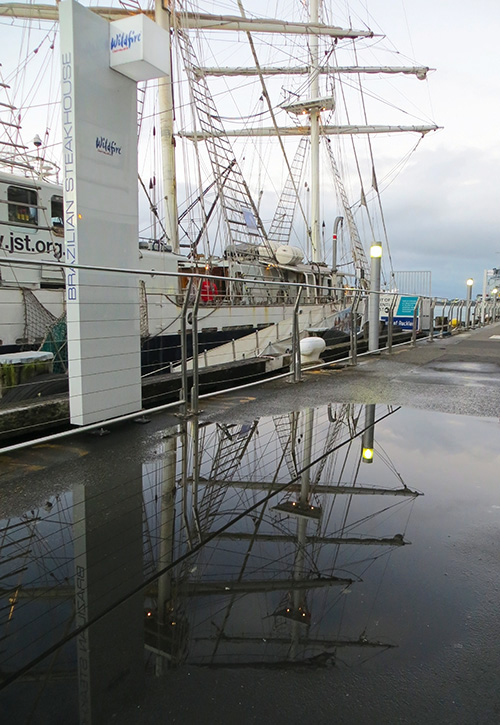 'Lord Nelson' and a puddle on the quayside, Auckland.