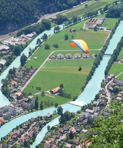 Looking down on a paraglider.