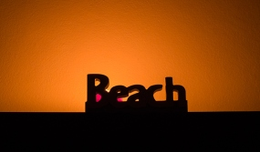 """""""Beach"""" backlit by candle."""