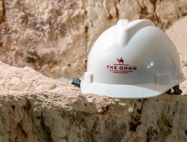 Smooth hard hat and rough rock -- Coober Pedy opal mine visited from The Ghan train.