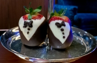 strawberries wearing chocolate tuxedos